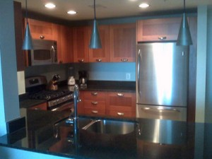 The Kitchen Features Italian Cabinetry, Granite Countertops, Stainless  Steel Appliances And Gas Cooking.
