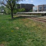 Railroad tracks separate the park from the city
