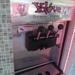 A self serving frozen yogurt machine with different flavors