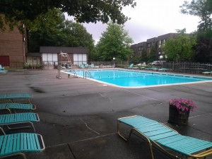 A swimming pool across from the units