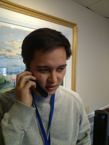 Stuart takes a phone call