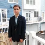 Stuart Nesbitt standing on a balcony at Old Town Commons