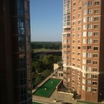 The view of a Carlyle Towers condo facing towards DC during the day