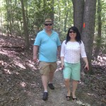 Will and Julie Nesbitt walk a path to the water park at Pohick Regional Park