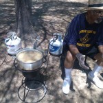 A gentleman fries some food at Pohick Regional Park