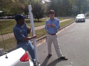 Realtor Stuart Nesbitt chats with a handyman