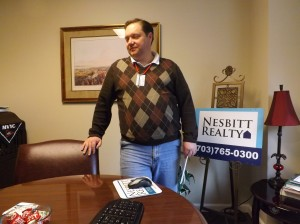 Will Nesbitt sits in the consultation room