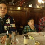 Father, son and brother at the dinner table