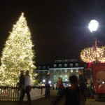 A Christmas tree shines in the night in Old Town Alexandria