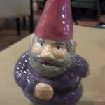 A custom painted garden gnome at Paint This! Ceramics Studio in Old Town