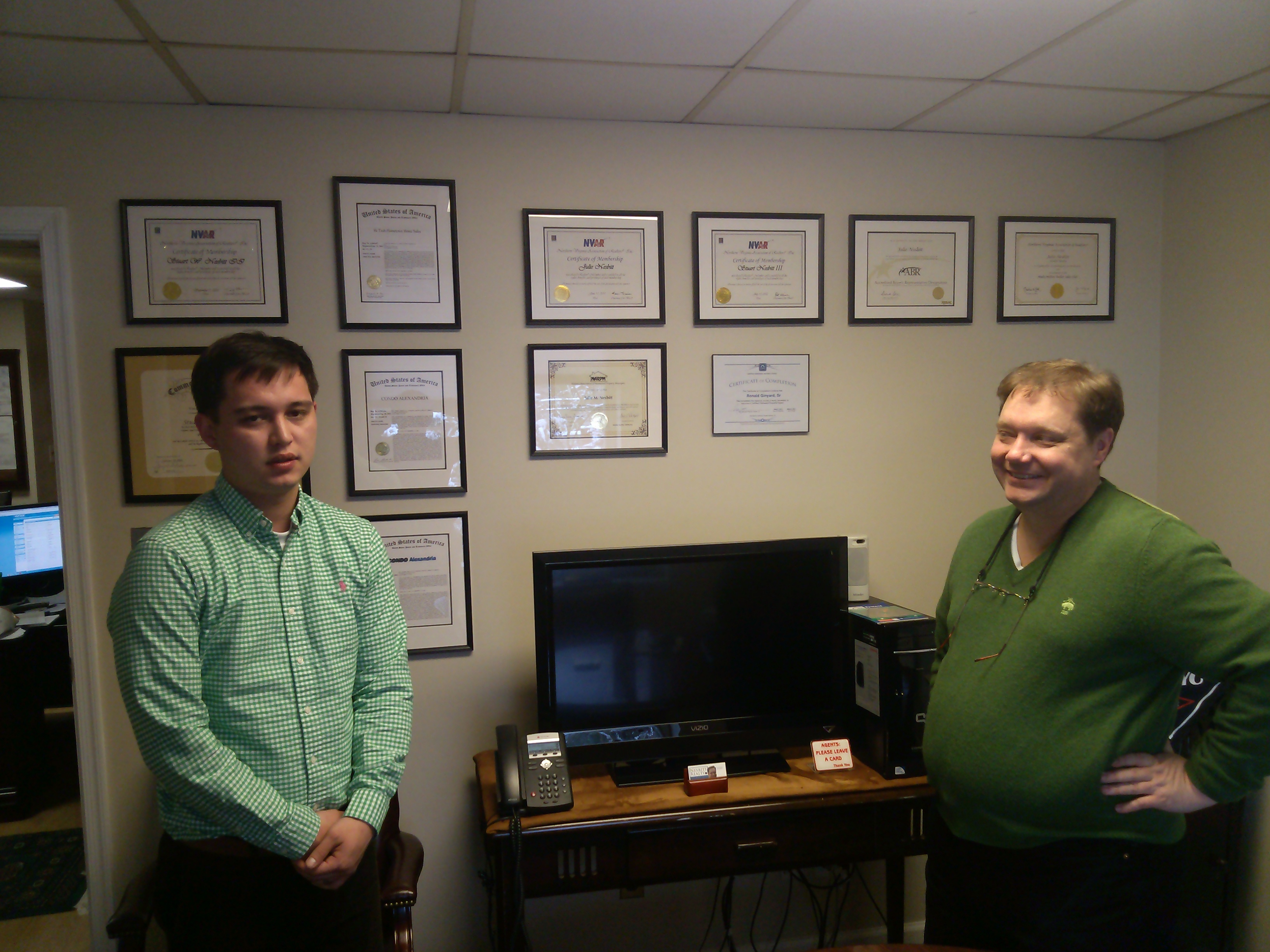 Father and son celebrate Saint Patrick's Day by wearing green at the office