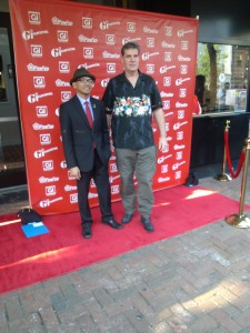 A gentleman gets a photo with one of the film directors