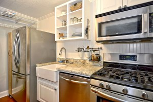 Refrigerator, sink, dishwasher, and stove in this condo