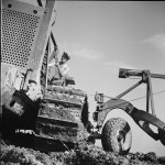 A soldier operating a tractor on Fort Belvoir, in 1942