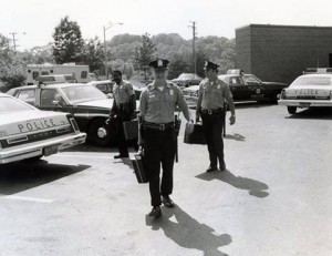 --McLean Patrol officers heading for the street, c. 1979