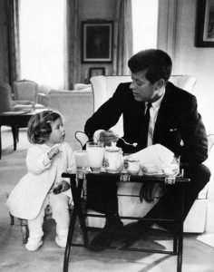 John F. Kennedy has a tea party with his daughter, Caroline. C. 1960