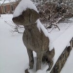dog statue in winter