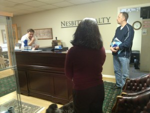 Spouses in discussion with client on property management benefits