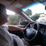 Principal Broker Will Nesbitt driving his sports utility vehicle Lincoln via Arlington