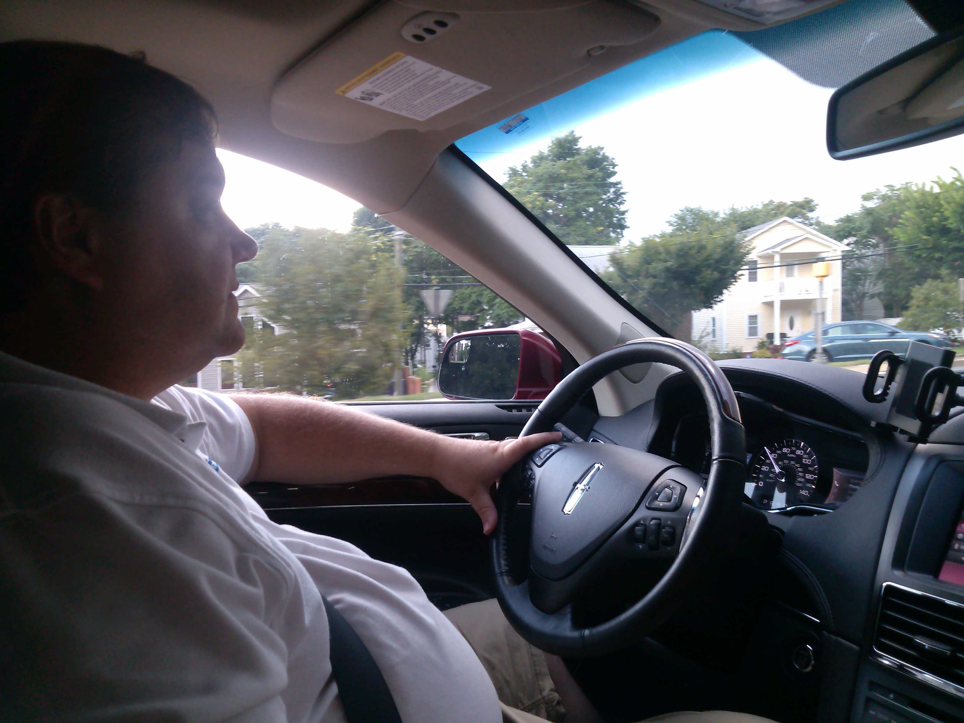 Principal Broker Will Nesbitt driving his sports utility vehicle Lincoln via Arlington
