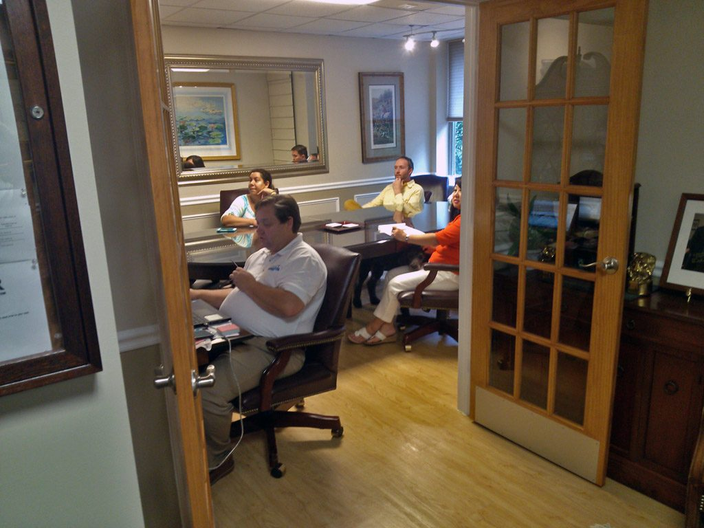 Broker and Agents in conference room
