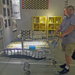 Will Nesbitt, Principal Broker eyeballs furniture in Woodbridge