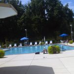 Outdoor pool amenity, furnished near trails