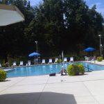Outdoor pool amenity, furnished near trails