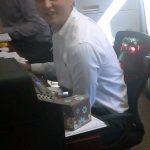 Seated Stuart Nesbitt, Real Estate Agent works on leads