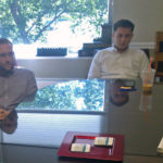 Realtors, Stuart Nesbitt, Andrew Patton, Nora Yelland, participate in Real Estate team meeting