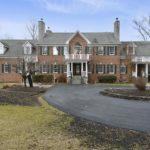 brick home, circular driveway